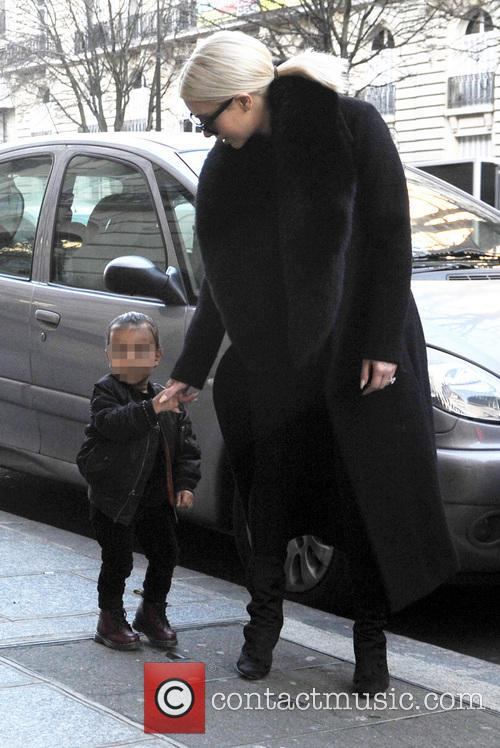 Kim Kardashian out in Paris with her daughter
