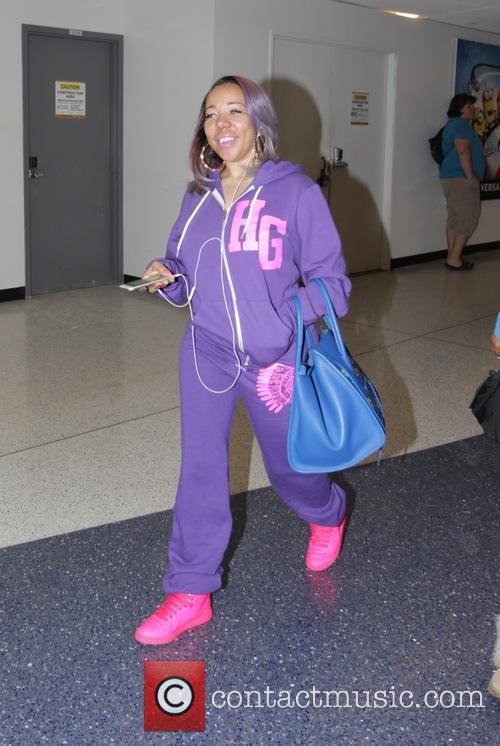 Tameka 'Tiny' Harris arrives at Los Angeles International...