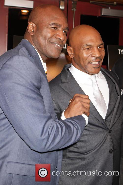 Evander Holyfield and Mike Tyson 7