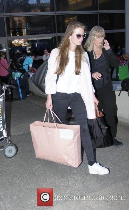 Mia Goth arrives at Los Angeles International Airport