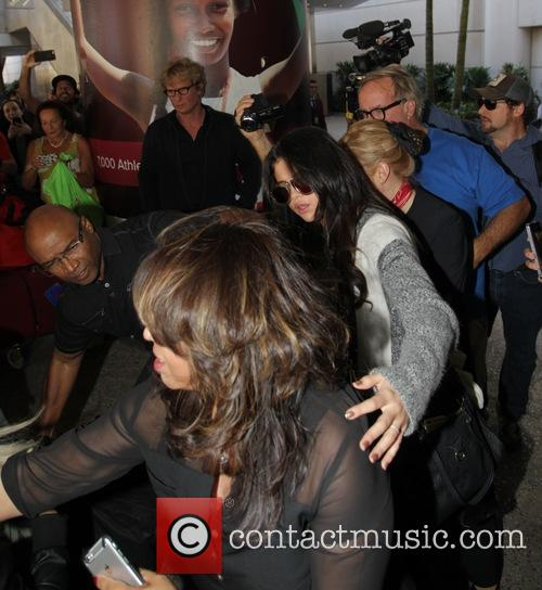 Selena Gomez is mobbed at Los Angeles International...
