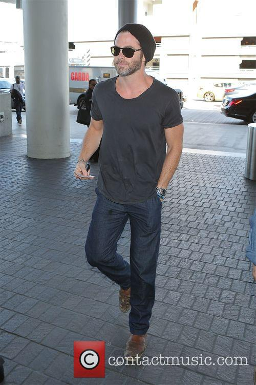 Chris Pine at Los Angeles International Airport to...