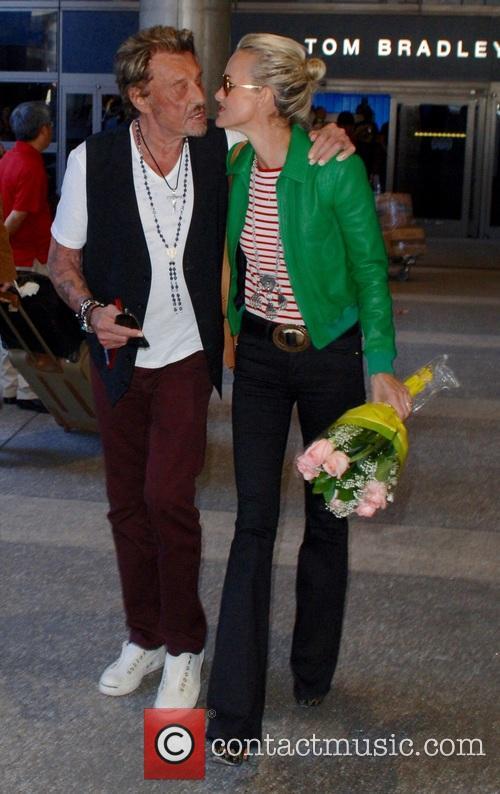Johnny Hallyday arrives at Los Angeles International (LAX)...