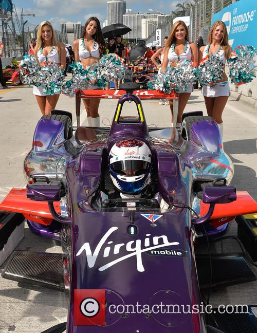 Sir Richard Branson watches Virgin Racing Team in...