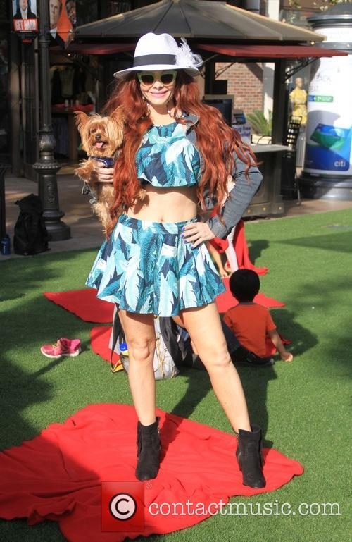 Phoebe Price poses with her dog at The...