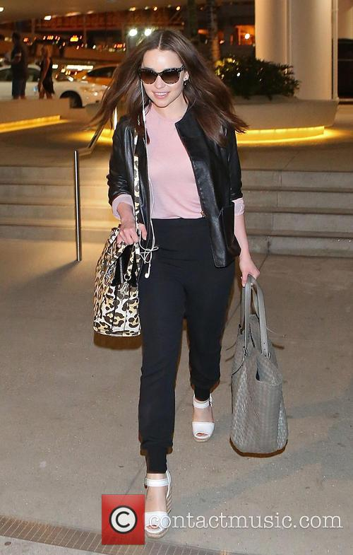 Emilia Clarke departs from Los Angeles International (LAX)...