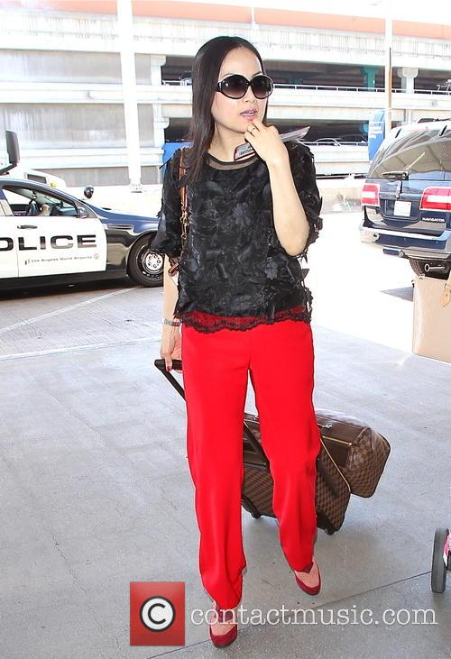 Ha Phuong departs from Los Angeles International (LAX)...