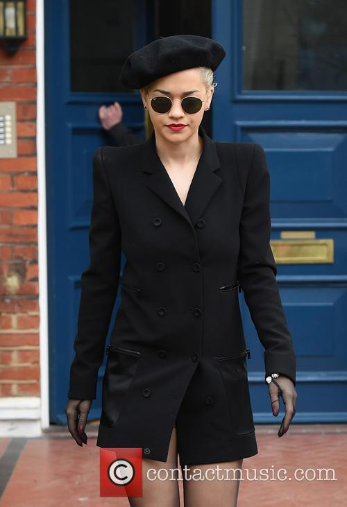 Rita Ora leaves her home in an all...