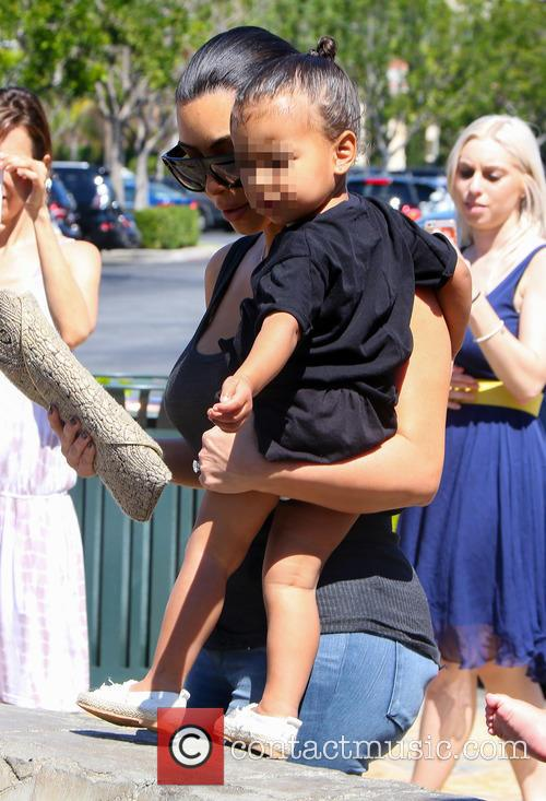 Kim Kardashian and North West 11