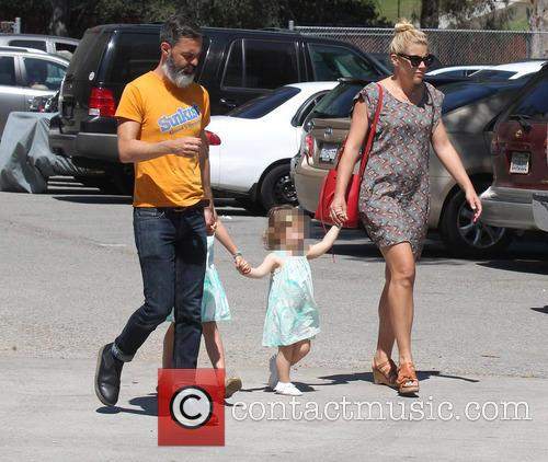 Busy Philipps with husband Marc Silverstein with their...
