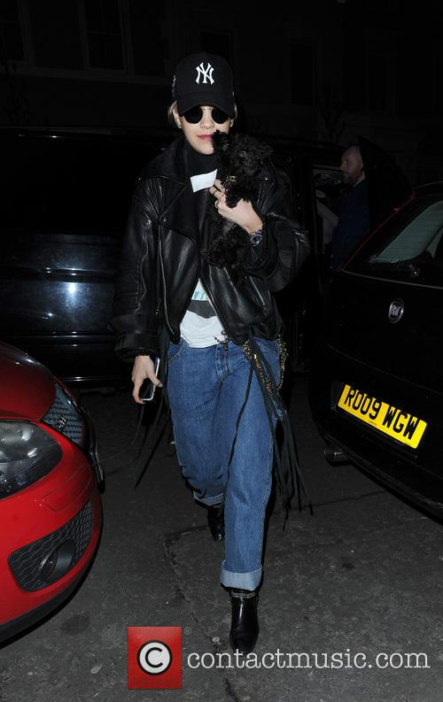Rita Ora arrives home holding her puppy Cher,...