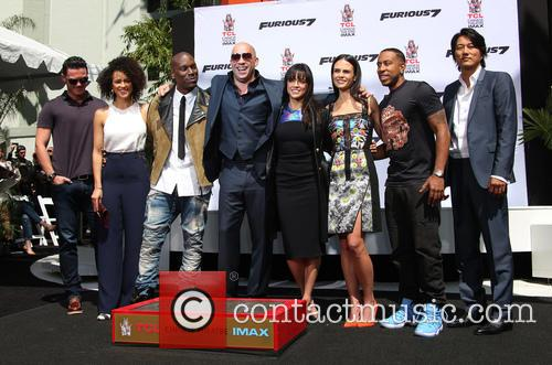 Luke Evans, Nathalie Emmanuel, Tyrese Gibson, Vin Diesel, Michelle Rodriguez, Jordana Brewster, Ludacris and Sung Kang 4