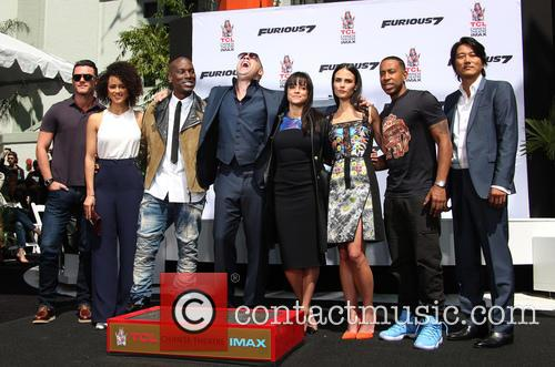 Luke Evans, Nathalie Emmanuel, Tyrese Gibson, Vin Diesel, Michelle Rodriguez, Jordana Brewster, Ludacris and Sung Kang 6