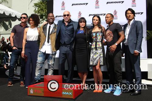 Luke Evans, Nathalie Emmanuel, Tyrese Gibson, Vin Diesel, Michelle Rodriguez, Jordana Brewster, Ludacris and Sung Kang 8