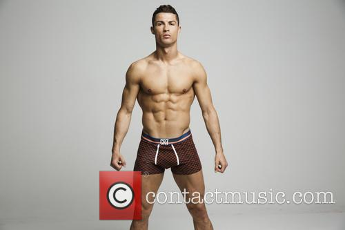 Cristiano Ronaldo celebrates the launch of his CR7...