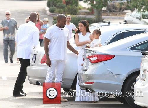 Kanye West, Kim Kardashian, North West and Corey Gamble 7