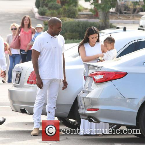 Kanye West, Kim Kardashian and North West 4