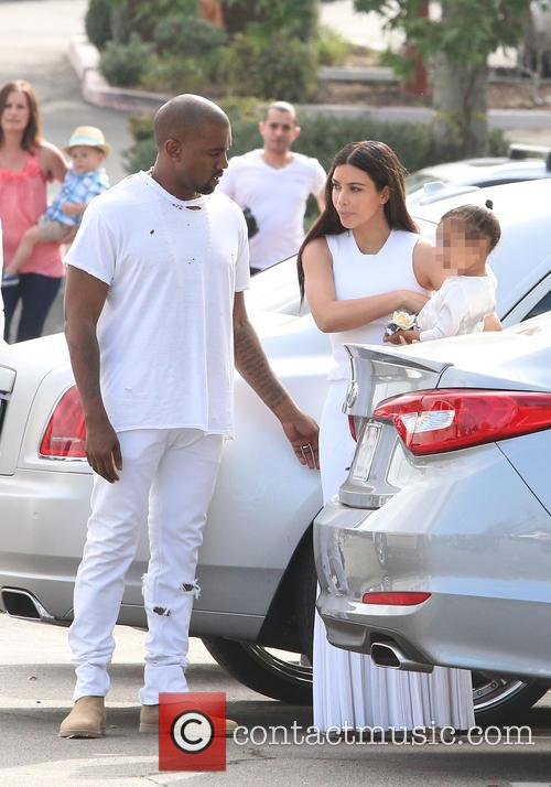 Kanye West, Kim Kardashian and North West 6