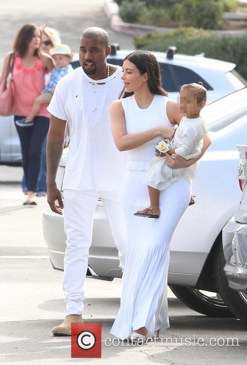 Kanye West, Kim Kardashian and North West 9