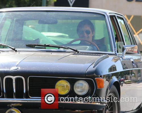 Olivier Martinez driving a vintage BMW