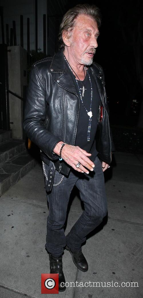 Johnny Hallyday and his wife Laeticia leaving Koi...