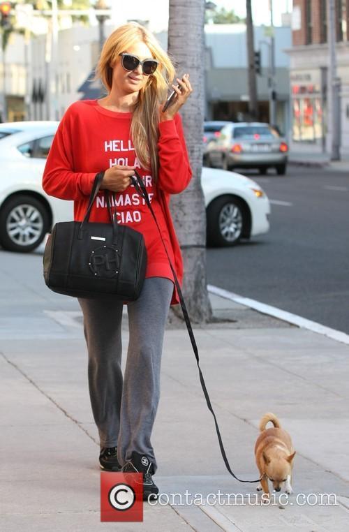 Paris Hilton walking her pet dog in Beverly...