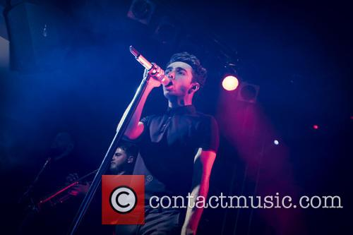 Nathan Sykes performing live in concert