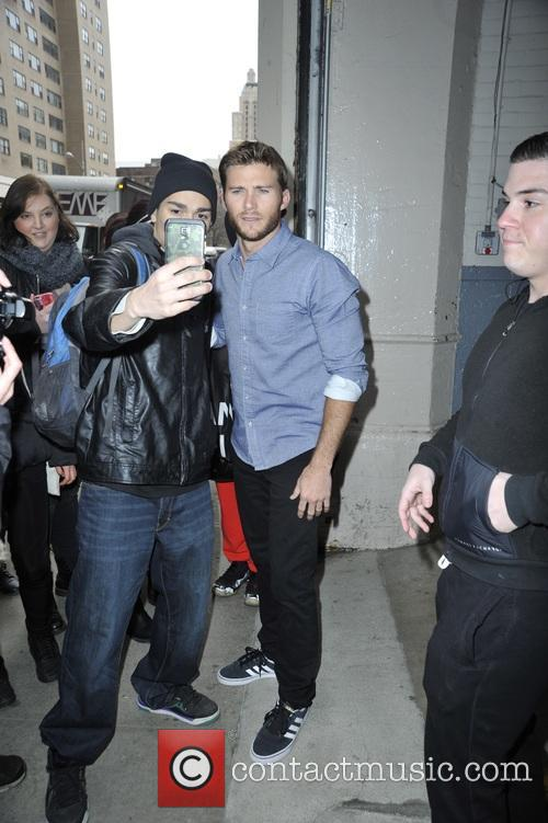Scott Eastwood poses with fans