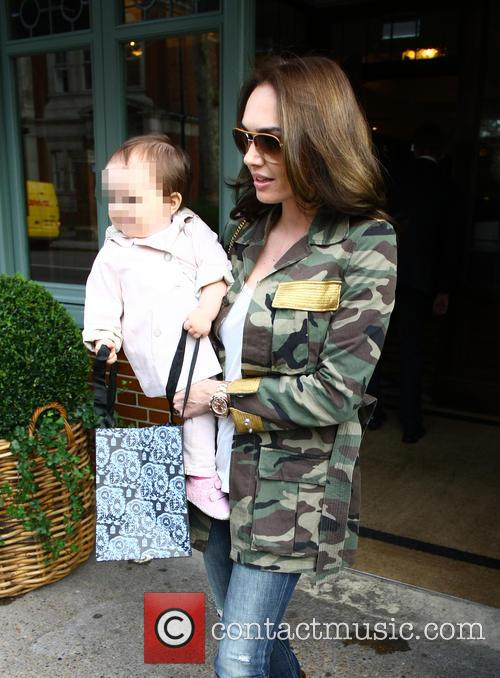 Tamara Ecclestone leaving The Ivy with her daughter...