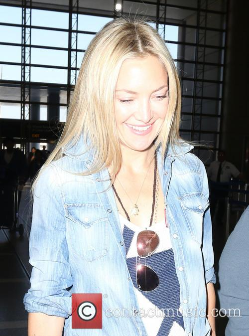 Kate Hudson arrives at Los Angeles International Airport...