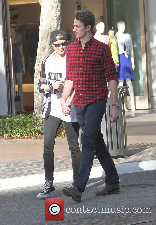 Evan Rachel Wood hold hands with Michael Thomas...