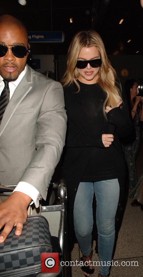 Khloe Kardashian arrives back on a flight from...