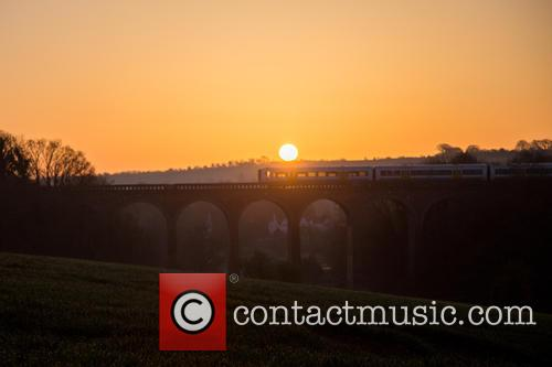 The sun rises over the Darenth Valley in...