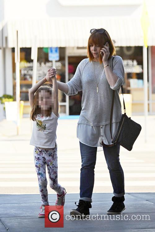 Alyson Hannigan shopping with her daughter
