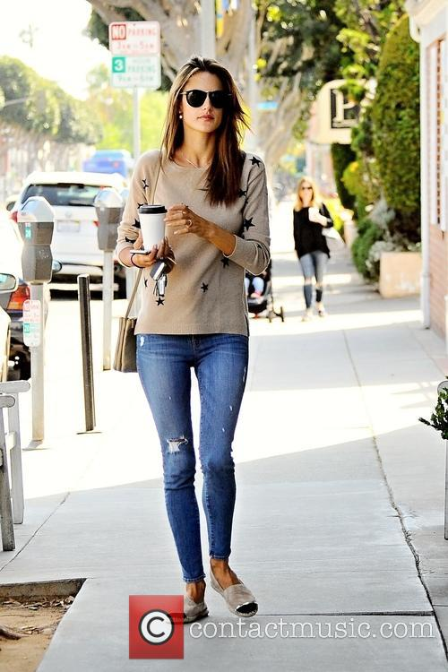 Alessandra Ambrosio grabbing a cup of coffee