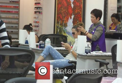 Rhea Durham goes to a nail salon in...