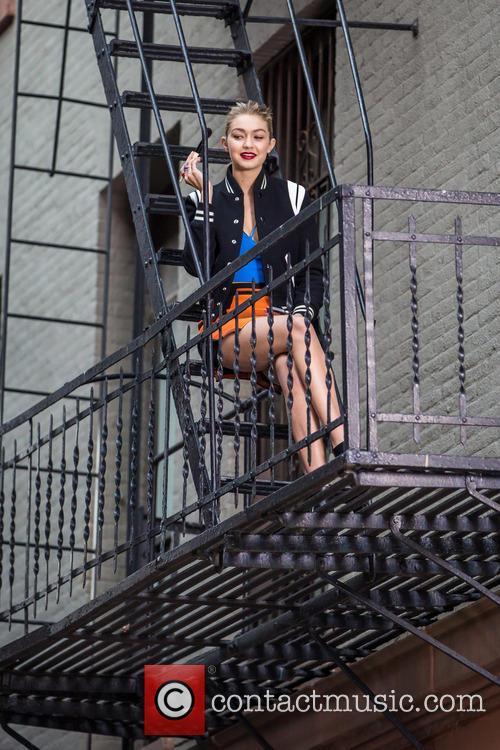 Adriana Lima and Gigi Hadid modelling on a...