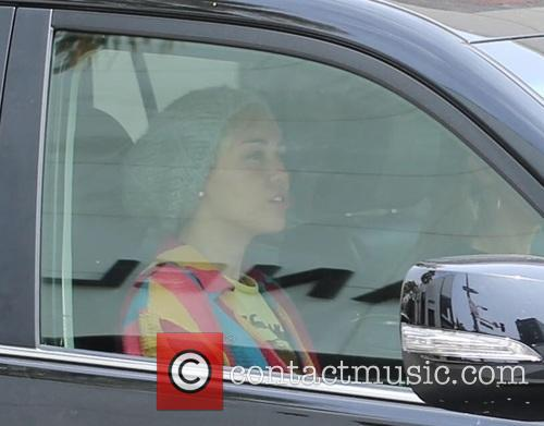 Miley Cyrus shops at Chanel on Rodeo Drive