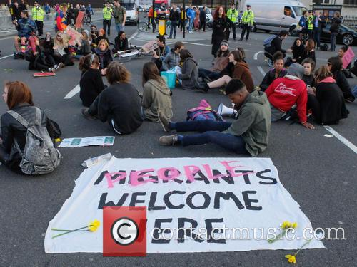 Die-in protest for immigration causes traffic chaos in...