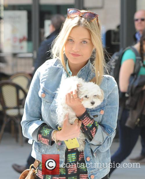 Laura Whitmore out in London with her Dog