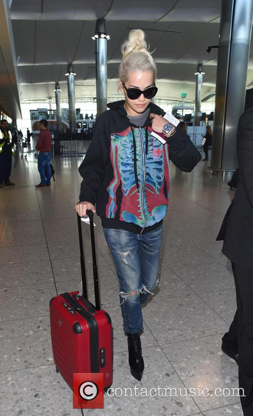 Rita Ora arrives at Heathrow airport
