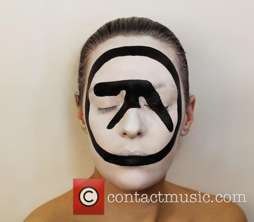 Artist Creates Album Covers...On Her Face!