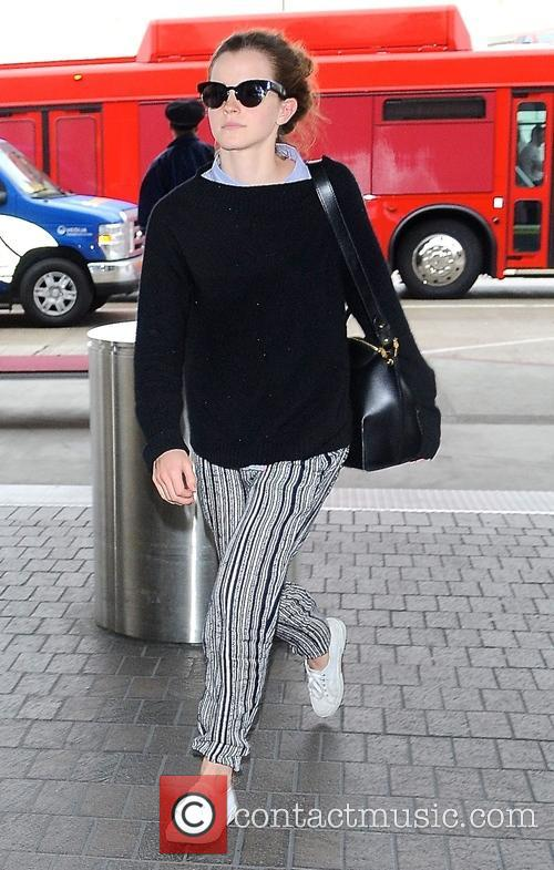 Emma Watson arrives at Los Angeles International (LAX)...