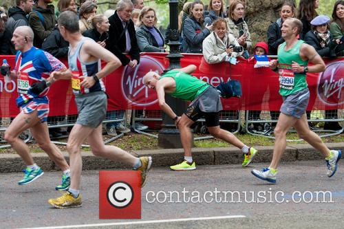 Contestants struggle during the final kilometre of the...