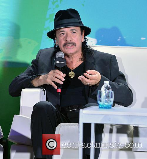 Leila Cobo and Carlos Santana 1