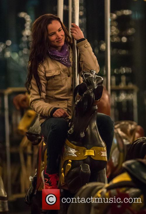 Juliette Lewis takes a ride on a carousel...