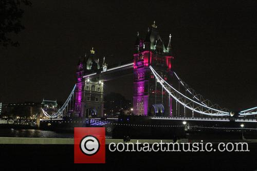 Tower Bridge turned a shade of pink to...