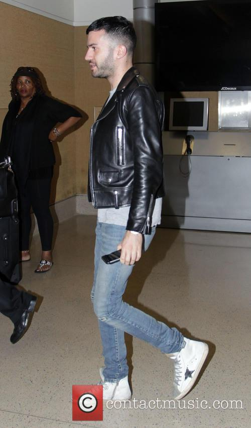 A-Trak, arrives at Los Angeles International Airport