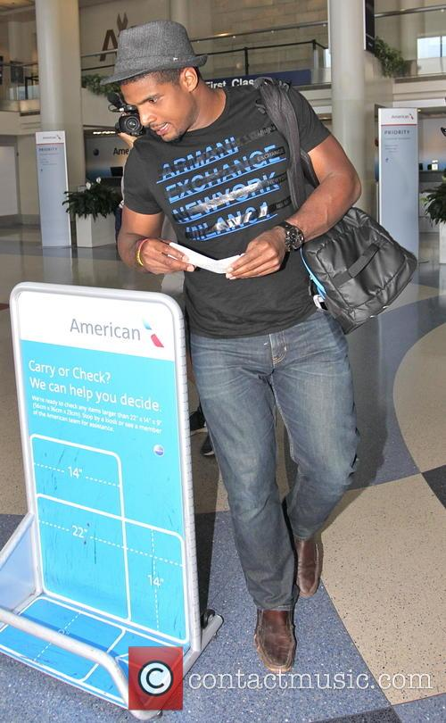 Michael Sam departs on a flight from Los...
