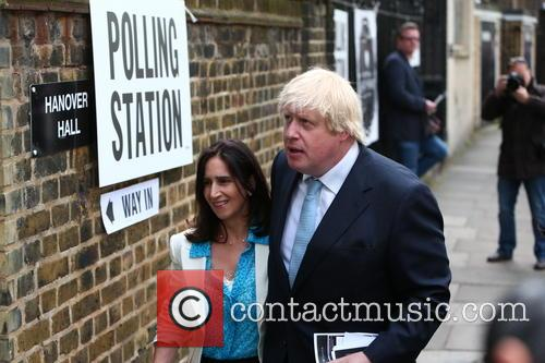 Boris Johnson arrives at a London polling station